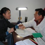Dr. Fang performing tongue diagnosis, Chengdu